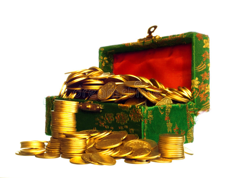 Riches, gold coins in a chest. Isolated on white royalty free stock photography