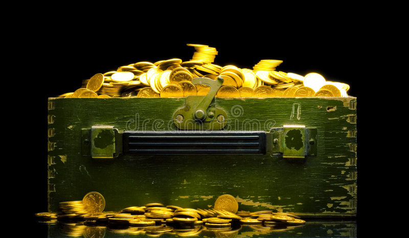 Riches, gold coins in a chest. Isolated on black stock photo
