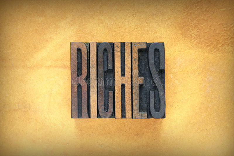 Riches Letterpress. The word RICHES written in vintage letterpress type royalty free stock photos