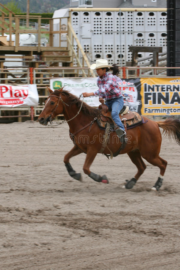 Richest Indian Rodeo. MERRITT, B.C. CANADA - MAY 22: Cowgirl barrel racing event at Richest Indian Rodeo May 22, 2010 in Merritt British Columbia, Canada stock photos