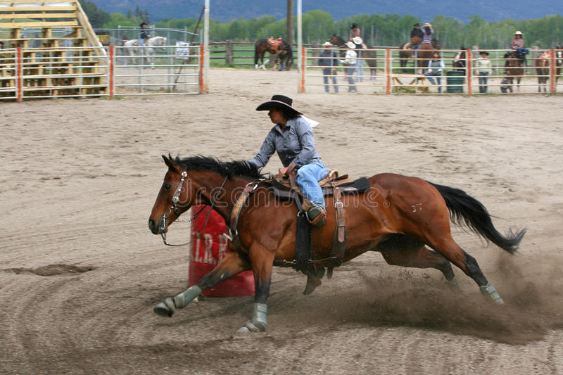 Richest Indian Rodeo. MERRITT, B.C. CANADA - MAY 22nd: Cowgirl barrel racing event at the Richest Indian Rodeo May 22, 2010 in Merritt British Columbia, Canada stock photos