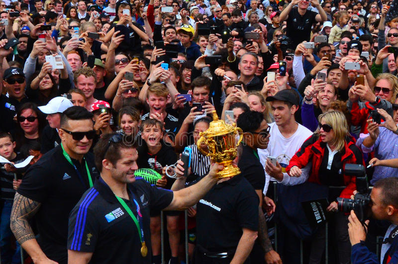 Richie McCaw showing thousands of people the Web Ellis trophy. AUCKLAND, NZL - NOV 04 2015:Richie McCaw showing thousands of people the Web Ellis trophy in royalty free stock images