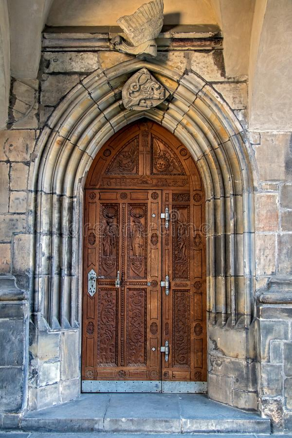 Richly carved oak door with portal at St. Vitus Cathedral Prague royalty free stock image