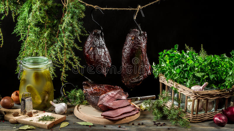 Richly filled farmhouse table with fresh ham royalty free stock photo