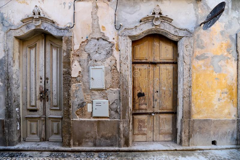 Richly ornamented doors in the old town of Olhao,. Richly ornamented doors in shabby but picturesque old houses in the historical part of Olhao, Algarve royalty free stock photography