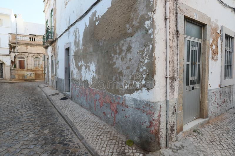 Richly ornamented houses in the old town of Olhao,. Richly ornamented houses, some places are shabby but picturesque in the historical part of Olhao, Algarve royalty free stock photography