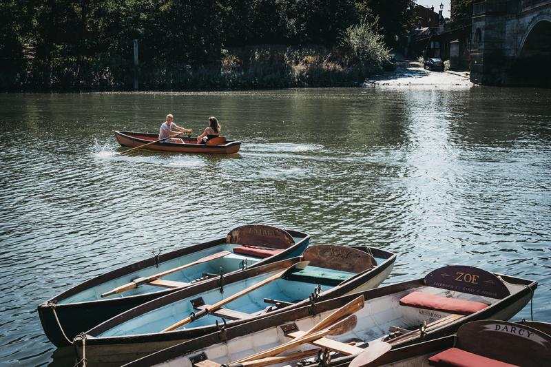 Richmond Bridge Boat Hire boats moored on the River Thames in Ri. London, UK - August 1, 2018. Richmond Bridge Boat Hire boats moored on the River Thames in royalty free stock image