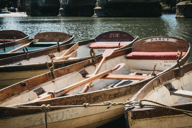 Richmond Bridge Boat Hire wooden boats moored on the River Thames in Richmond, London, UK. stock images