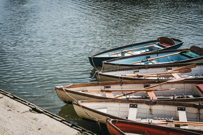 Richmond Bridge Boat Hire wooden boats moored on the River Thames in Richmond, London, UK. London, UK - August 1, 2018. Richmond Bridge Boat Hire wooden boats royalty free stock photos
