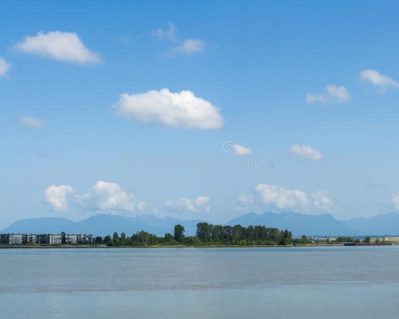 RICHMOND, CANADA - AUGUST 3, 2019: Panoramic view of Fraser river commercial shipping. Transport, water, business, coast, landscape, transportation, canadian royalty free stock photography