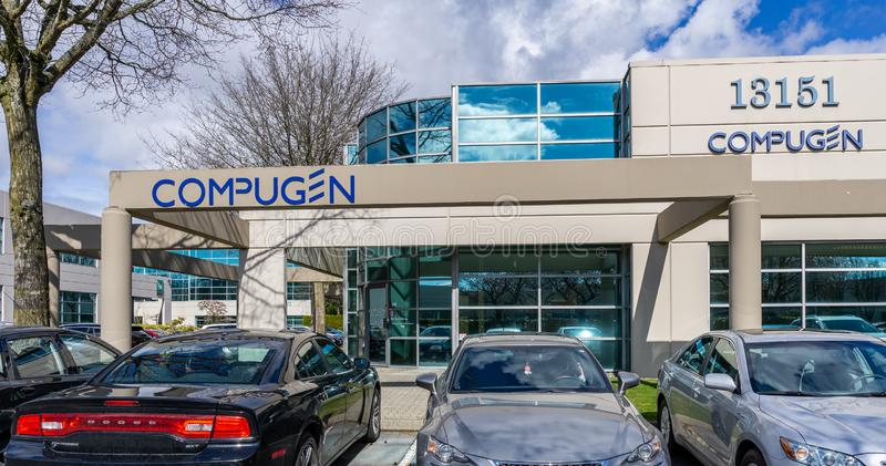 RICHMOND, CANADA - MARCH 26, 2019: modern business building with offices parking lot and cars. Industry, exterior, commercial, sale, road, new, service royalty free stock photo