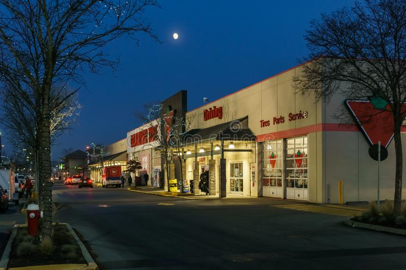 RICHMOND, CANADA - NOVEMBER 19, 2018: Canadian Tire storefront at night with moon on the sky stock images