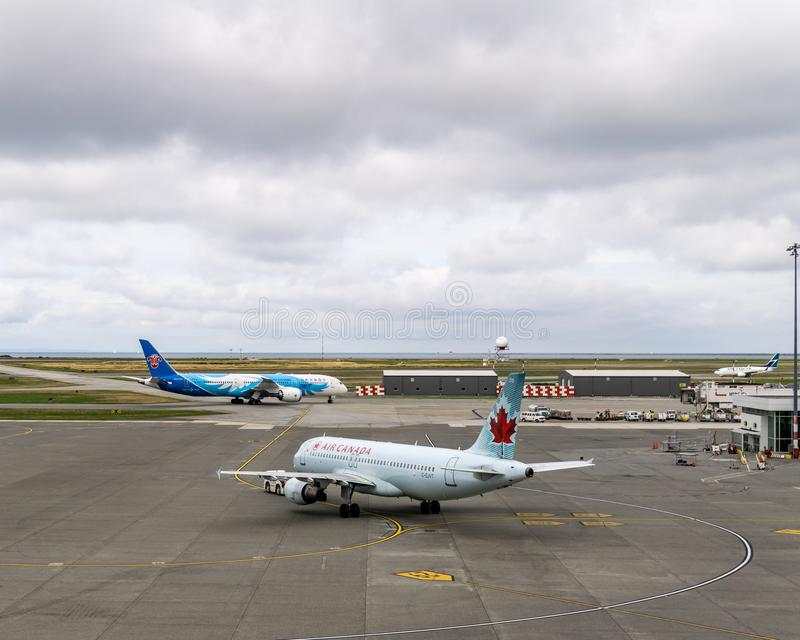 RICHMOND, CANADA - September 14, 2018: Busy life at Vancouver International Airport aircraft and cargo.  royalty free stock image