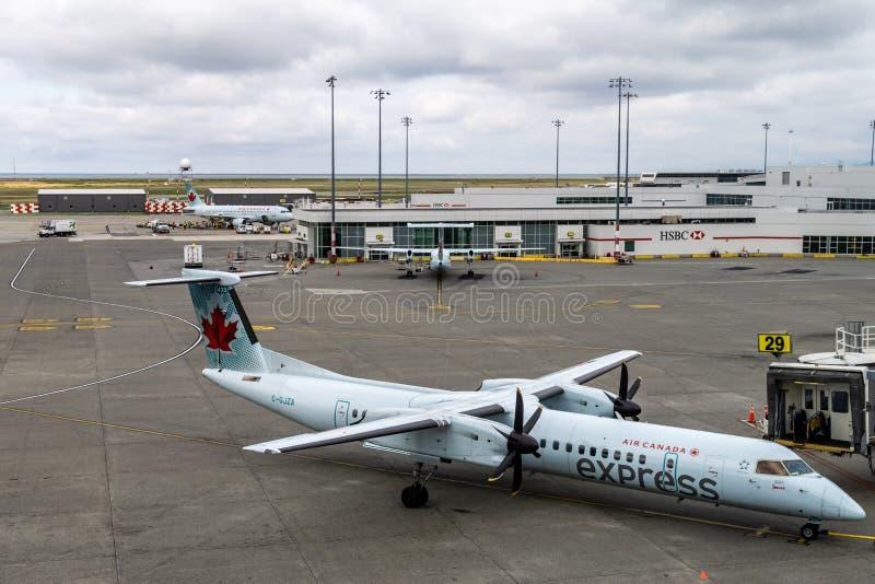 RICHMOND, CANADA - 14 septembre 2018 : La vie occupée aux avions et à la cargaison d'aéroport international de Vancouver photographie stock