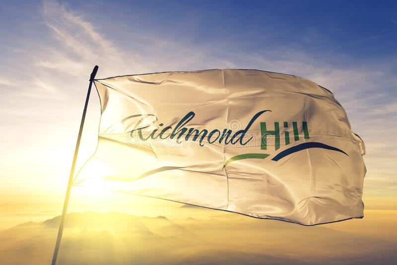 Richmond Hill of Ontario of Canada flag waving on the top sunrise mist fog. Richmond Hill of Ontario of Canada flag textile cloth fabric waving on the top royalty free stock photos