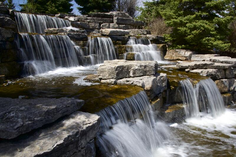 Beautiful view of waterfall in public pard at Richmond Hill, Ontario, Canada. Richmond Hill, Ontario / Canada - May 08, 2019: beautiful view of waterfall in royalty free stock photos