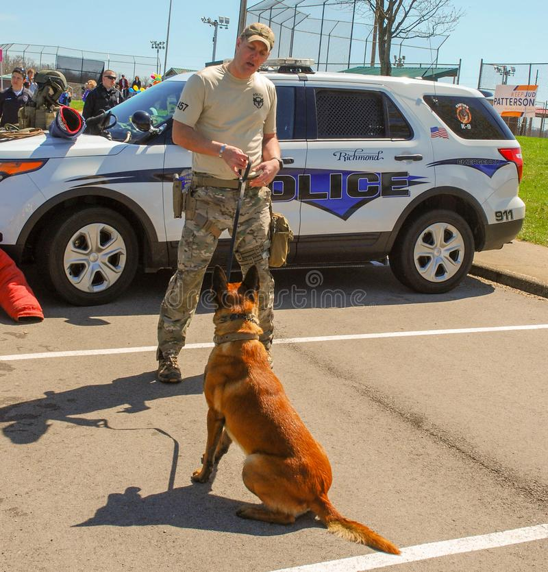 Richmond, KY US - March 31, 2018 - Easter Eggstravaganza A K9 Officer demonstrates canine techniques and training exercises stock photography