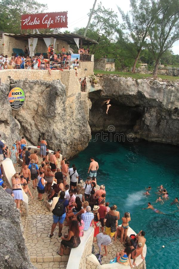Rick`s Cafe in Negril, Jamaica. Rick`s Cafe, Jamaica - October 11: Rick`s Cafe on October 11, 2017 in Jamaica. People have fun jumping at Jamaica`s famous Rick` stock images
