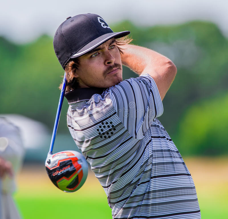 Rickie Fowler at the 2012 Barclays. FARMINGDALE, NY - AUGUST 21: Rickie Fowler hits a drive at Bethpage Black during the Barclays on August 21, 2012 in royalty free stock photography