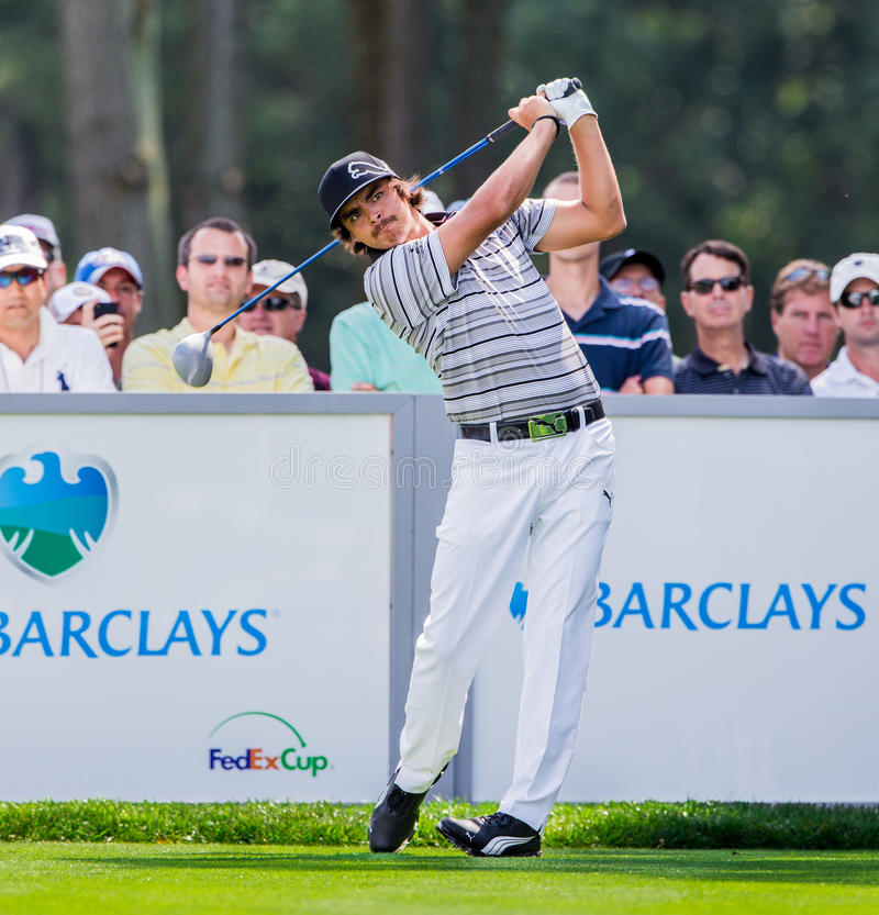 Rickie Fowler at the 2012 Barclays. FARMINGDALE, NY - AUGUST 21: Rickie Fowler hits a drive at Bethpage Black during the Barclays on August 21, 2012 in royalty free stock photo