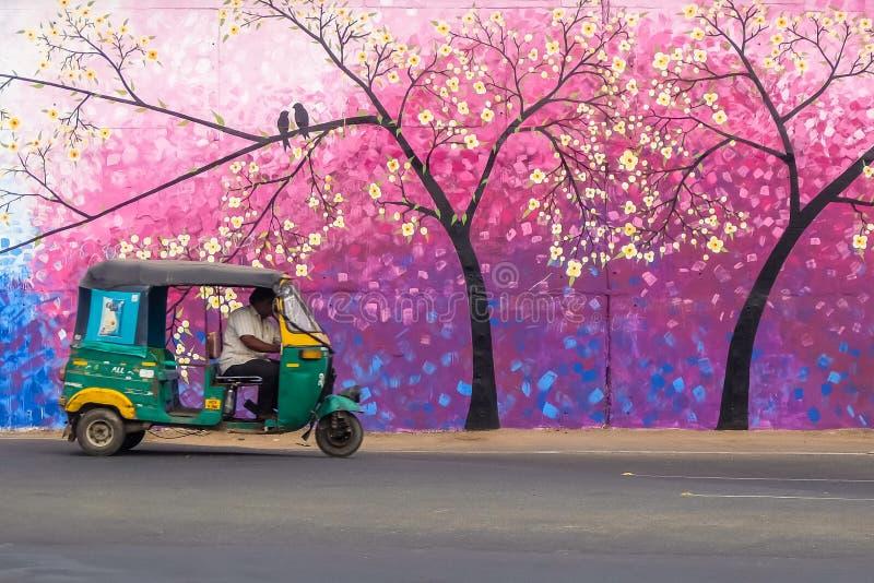 Rickshaw cab on the street of Vijayawada, India. Vijayawada, India - Circa January, 2018. Rickshaw cab on the street of Vijayawada, India royalty free stock photography