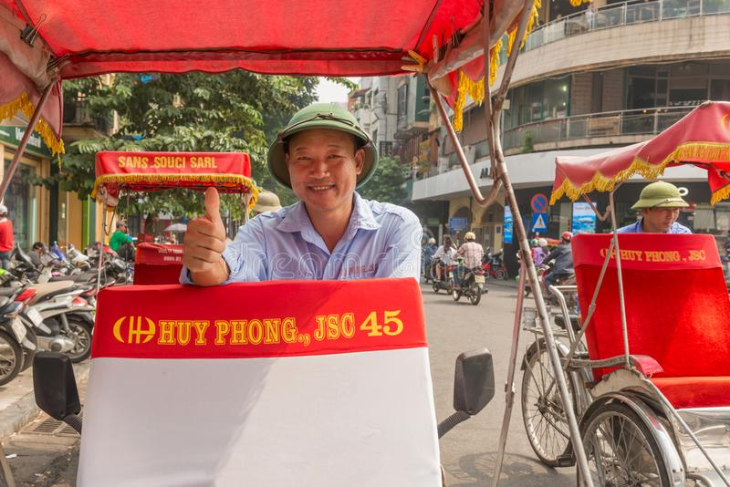 Rickshaw driver giving thumb up in Hanoi, Vietnam. royalty free stock photos