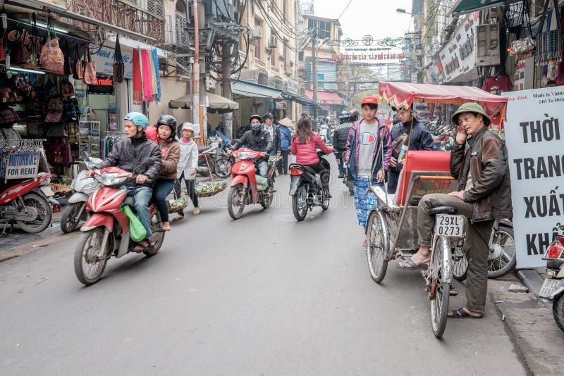 Rickshaw driver in Hanoi stock image