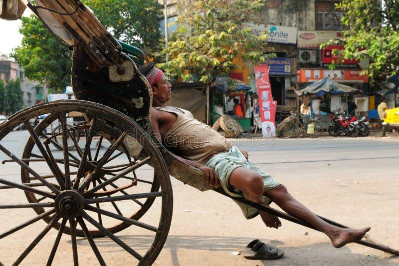 Rickshaw driver, India. INDIA, AMRITSAR - DECEMBER 07: Rickshaw driver with one's rickshaw in the street of Indian city, Amritsar in November 29, 2009 royalty free stock photo