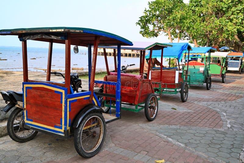 Rickshaw i Indonesien royaltyfria foton