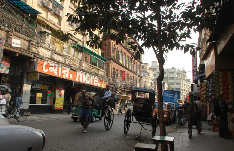 Rickshaw man pulls the customer, Kolkata royalty free stock image