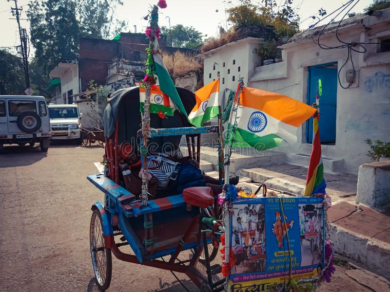 A rickshaw parked with national indian flag decorations on road in india dec 2019 royalty free stock image