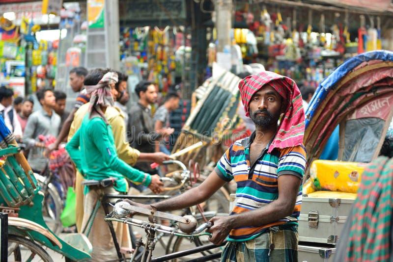 Rickshaw transportation in Dhaka, Bangladesh. DHAKA, BENGAL BANGLADESH - 24 JANUARY 2019: Rickshaw driver on crowded street of Dhaka in the Bangladesh royalty free stock photography