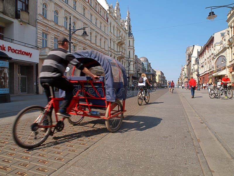 Rickshaws on the street Piotrkowska. stock images