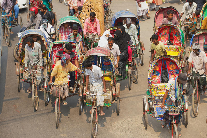 Rickshaws transport passengers in Dhaka, Bangladesh. DHAKA, BANGLADESH - FEBRUARY 22, 2014: Rickshaws transport passengers in Dhaka, Bangladesh. About 500 000 royalty free stock photography