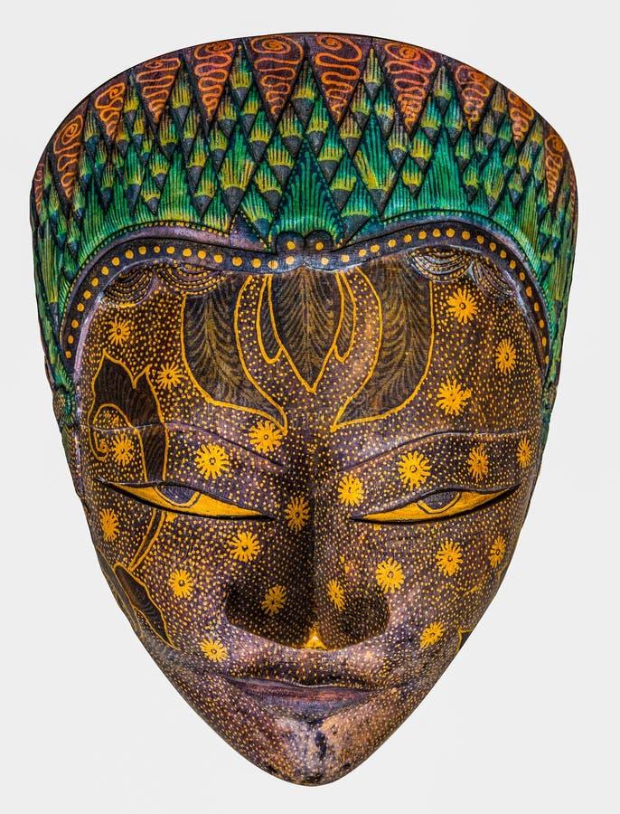 Ricordo di legno della maschera del batik isolato su fondo bianco fotografia stock