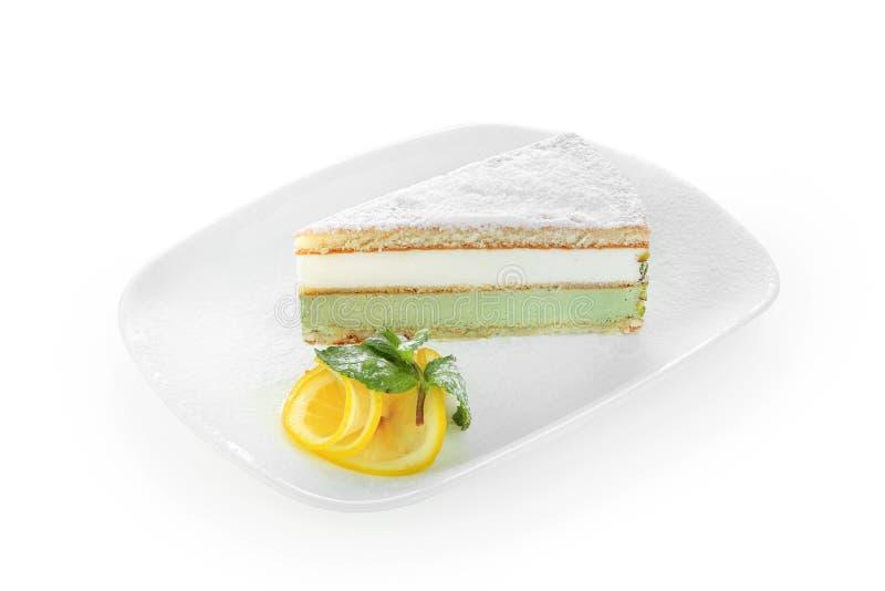 Ricotta cake pistachio on white plate. Ricotta cake pistachio on a white plate stock photos