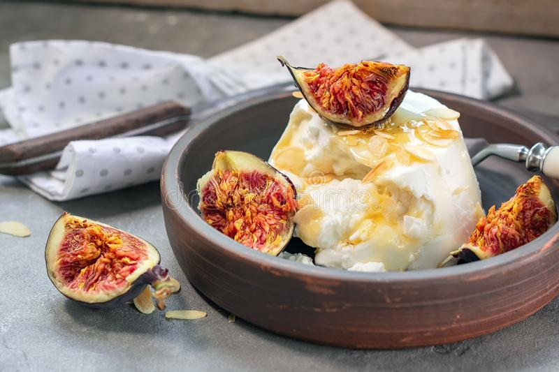 Ricotta cheese with baked figs. royalty free stock photo