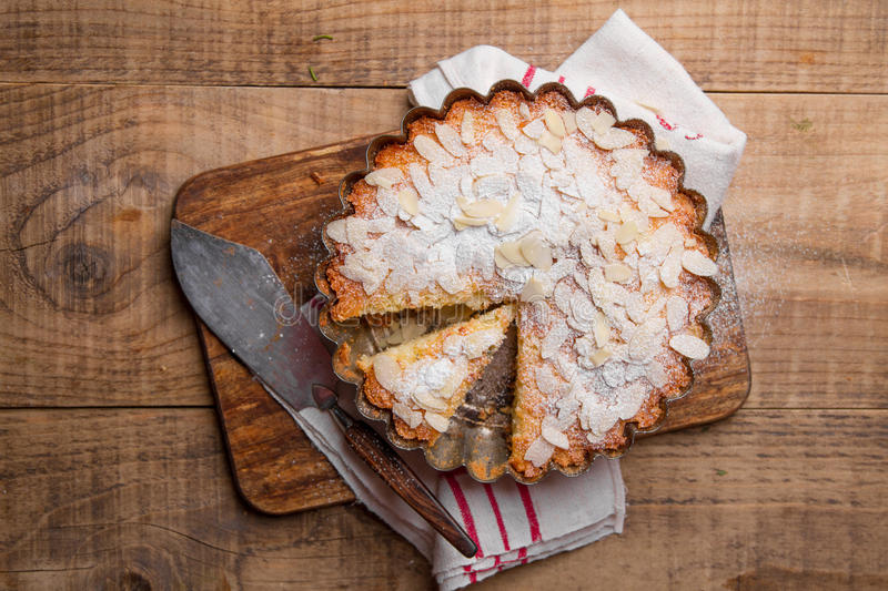 Ricotta cheese cake. With almond and lemon on wooden background, selective focus stock images