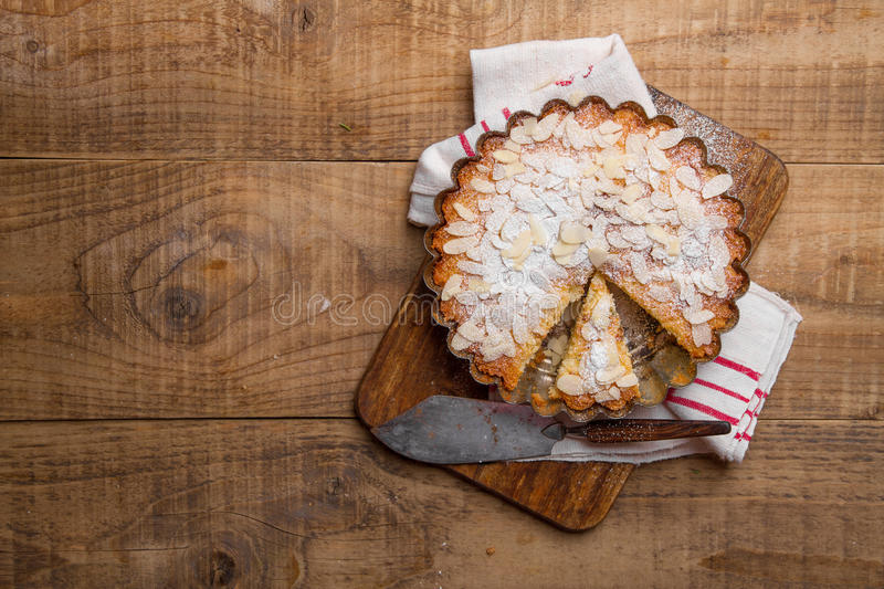 Ricotta cheese cake. With almond on wooden background, selective focus stock image