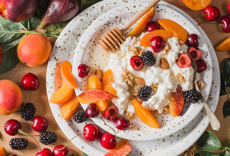 Ricotta cheese or cottage cheese with fruits. stock image