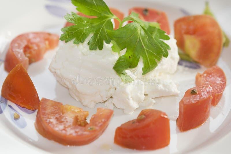 Ricotta en tomaten stock afbeeldingen