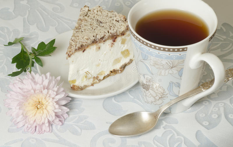 Ricotta and Pear Cake with cup of tea. And bouquet of chrysanthemums. From the series Italian desserts stock image