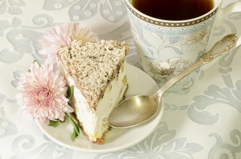 Ricotta and Pear Cake with cup of tea. And bouquet of chrysanthemums. From the series Italian desserts royalty free stock photography
