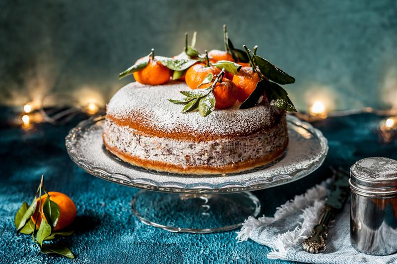 Ricotta Tangerine Cake. Fresh Ricotta, Pistachio, Chocolate and Tangerine Cake stock photo