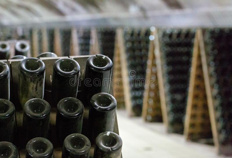 Riddling rack used for ageing sparkling wines royalty free stock photography