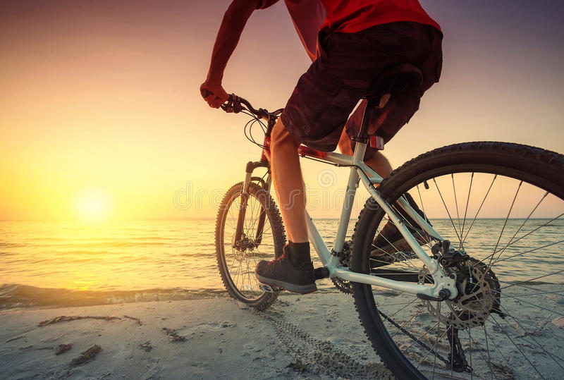 Ride on bike on the beach stock images