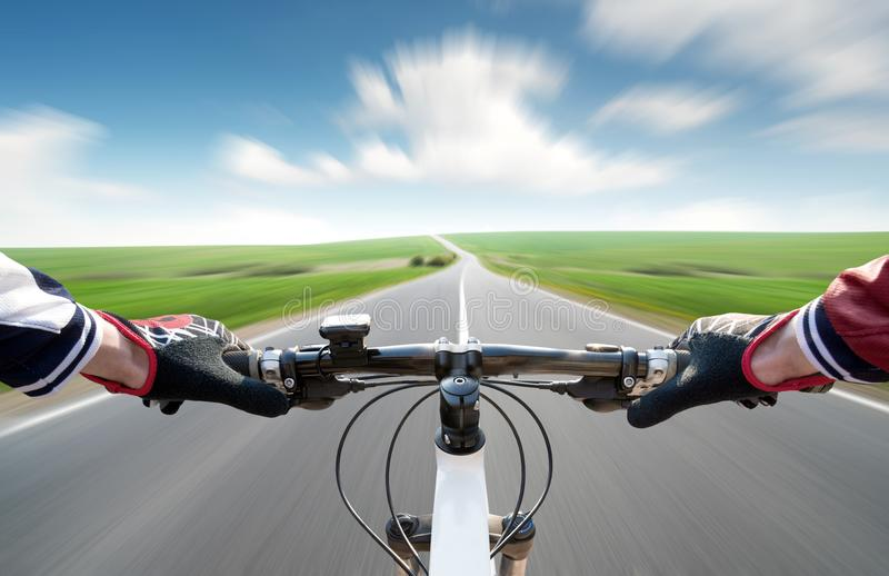 Ride on bycycle on road stock image
