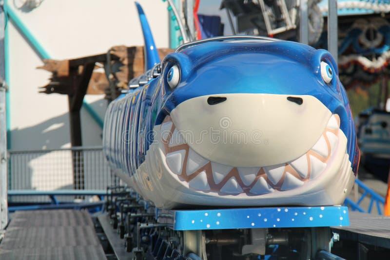 Ride at a Fun Fair. A Childrens Ride at a Fun Fair Amusement Park stock photos