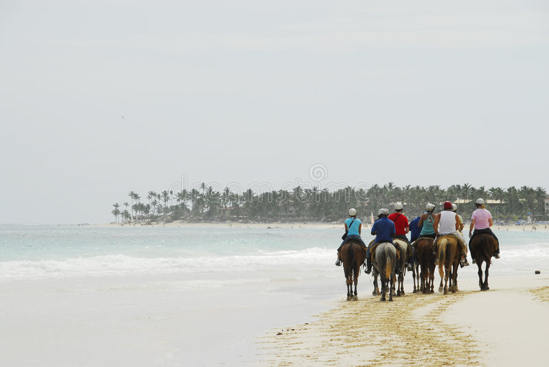Ride on horseback on a tropical beach royalty free stock images