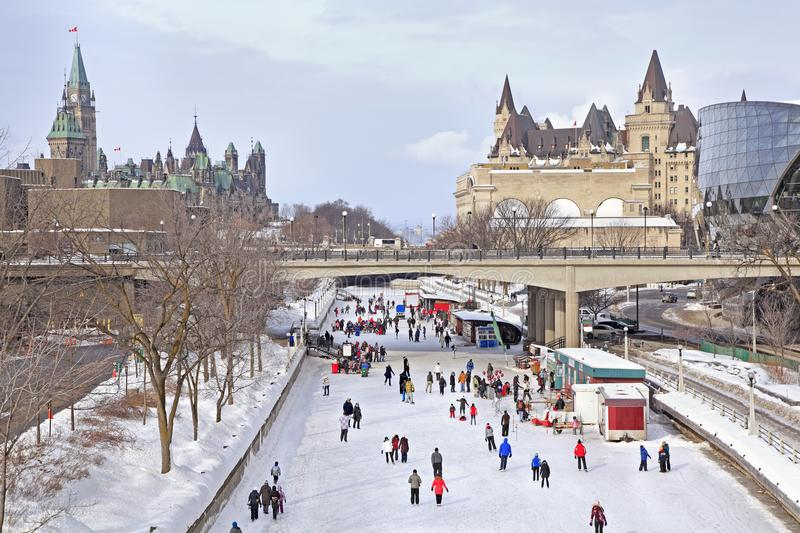 Rideau Canal Skating Rink in Ottawa and Canadian Parliament. People enjoying the Skating Rink in Ottawa, Canada. Canadian Parliament and Chateau Laurier on the stock image